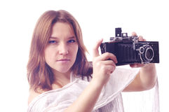 Young girl  with retro camera Stock Image