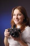 Young girl  with retro camera Stock Photos