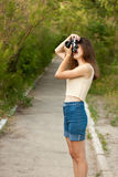 Young girl with retro photo camera. Outdoor Royalty Free Stock Photo