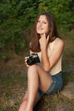 Young girl with retro photo camera. Outdoor Stock Photography