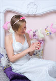 Young girl in a retro style wedding dress looking at wedding rin Royalty Free Stock Image