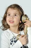 Young girl on the retro telephone Stock Photo