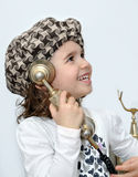 Young girl on the retro telephone Stock Photos