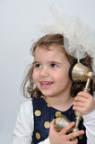 Young girl on the retro telephone Royalty Free Stock Image
