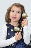 Young girl on the retro telephone Stock Photography