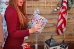 Young girl reveals her gift box. Christmas atmosphere. Indoors. Stock Photography