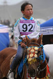 Young girl rides during Naadam Stock Photo