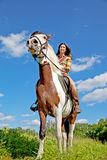 A young girl rides a paint horse Royalty Free Stock Photos