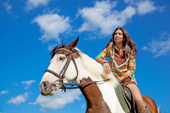 A young girl rides a paint horse Stock Photos