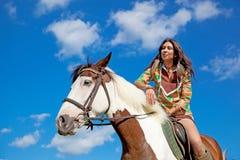 A young girl rides a paint horse Stock Photos