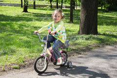 Young girl riding bicycle Royalty Free Stock Photos