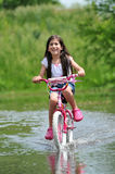 Young Girl Riding Bicycle Stock Photography