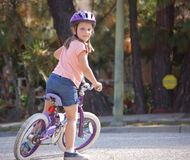 Young girl riding bicycle Stock Images