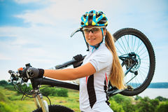 Young girl riding bicycle outside. Healthy Royalty Free Stock Image