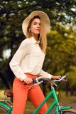 Young girl riding bicycle in park. In summer Stock Photo