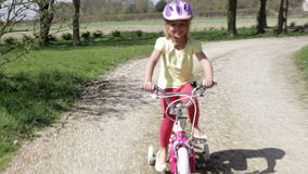 Young Girl Riding Bike Along Country Track Royalty Free Stock Images