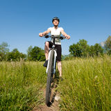 Young girl riding a bike offroad Stock Images