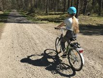 Young girl riding a bike in Polish countryside stock image