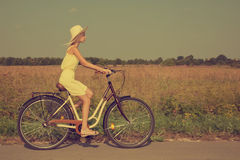 Young girl riding a bike. Royalty Free Stock Photo