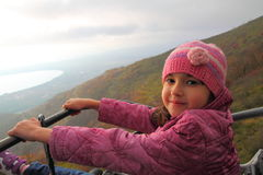 Young girl riding a cable car Royalty Free Stock Photo