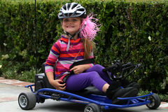 Young girl riding go cart Stock Photography