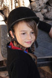 Young girl in riding helmet. Beautiful young girl at the stables, in her riding helmet Stock Photography