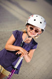 Young girl riding her scooter Royalty Free Stock Photo