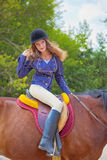 Young girl riding a horse. Stock Image