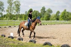 Young girl riding a horse Royalty Free Stock Photos