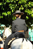 Young girl riding at horse in the Seville Fair, feast in Spain Royalty Free Stock Photo