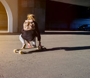 Young girl riding on a longboard in city Royalty Free Stock Photos