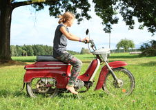 Young girl riding a motorbike Stock Image