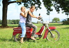 Young girl riding a motorbike Stock Photos