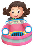 A young girl riding on a pink bumpcar Stock Photography