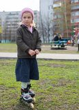 Young girl riding on roller skates. Royalty Free Stock Photo