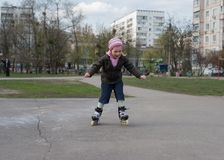 Young girl riding on roller skates. Stock Image