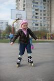 Young girl riding on roller skates. Royalty Free Stock Image