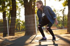 Young girl riding a skateboard. Skateboarding. Outdoors, lifestyle. Royalty Free Stock Image