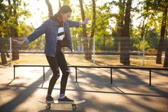 Young girl riding a skateboard. Skateboarding. Outdoors, lifestyle. Stock Images