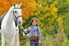 Young girl riding on white dressage horse Royalty Free Stock Images