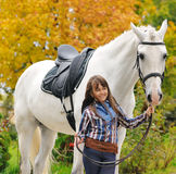 Young girl riding on white dressage horse Royalty Free Stock Photography