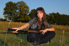 Young girl with rifle Stock Images