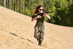 Young girl with a rifle Stock Photography