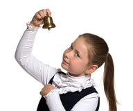 Young girl ringing a golden bell Royalty Free Stock Photography