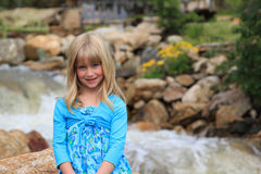 Young girl by a river stock photos