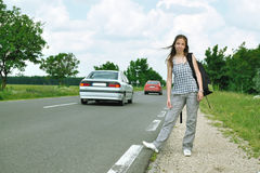 Young girl on the road Royalty Free Stock Images