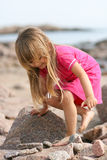 Young Girl a Rocky Beach Royalty Free Stock Images
