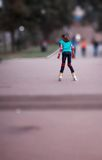 Young girl on roller blades Stock Photos