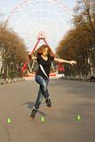 Young girl roller skates in the park Royalty Free Stock Photos