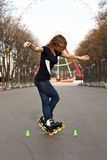 Young girl roller skates in the park Stock Photos